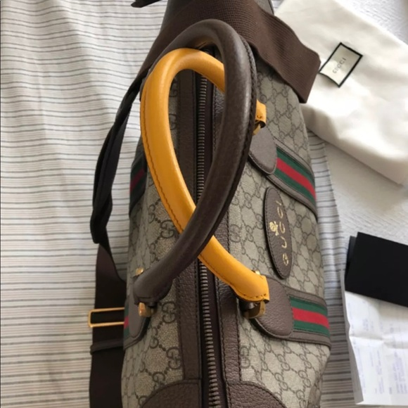 4cd7c2f141 Gucci soft GG Supreme duffle bag with web. NWT. Gucci.  M_5bb90dfd0cb5aa84e0337c51. M_5bb90dfe1b32942e8176bcc3.  M_5bb90dff819e9082ad07056c